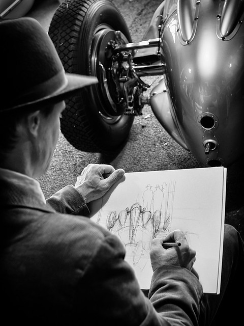 An Artist drawing one of the Silver Arrows