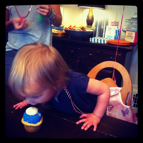 dipping into her cupcake
