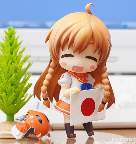Big smile while holding Japanese flag