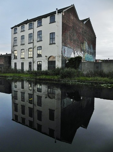 abandoned building beside the canal