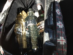 Liquid luggage - vodka, whisky, port in a luggage bag