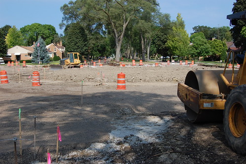 Street torn up and round circle of dirt being formed