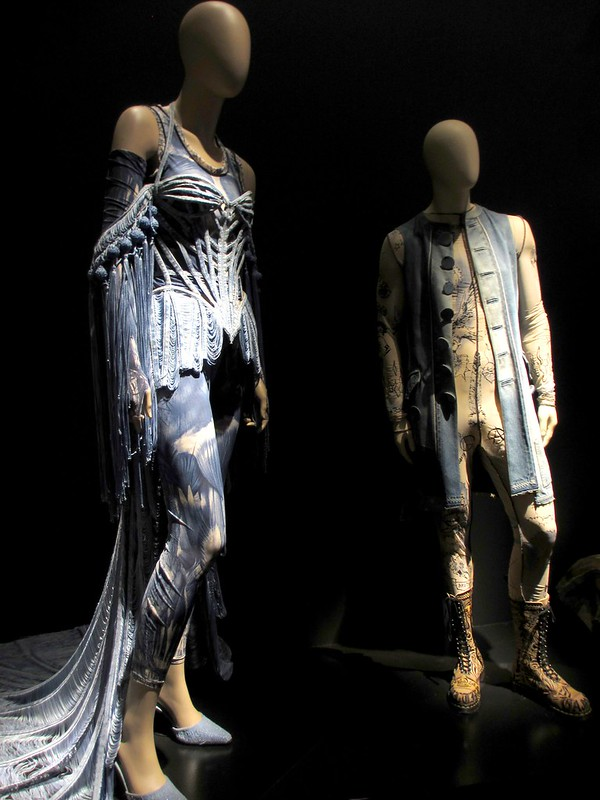 Corset in denim motif with train, Ze Parisienne collection, haute couture SS 2002. Top and leggings in Flayed Skin print, Bad Girls - G Spot collection, women's prêt-à-porter SS 2010.