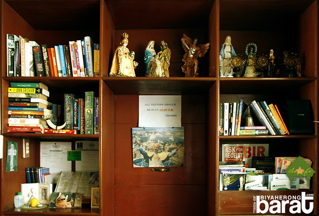 Books and images of saints behind Sanafe Lodge's front desk