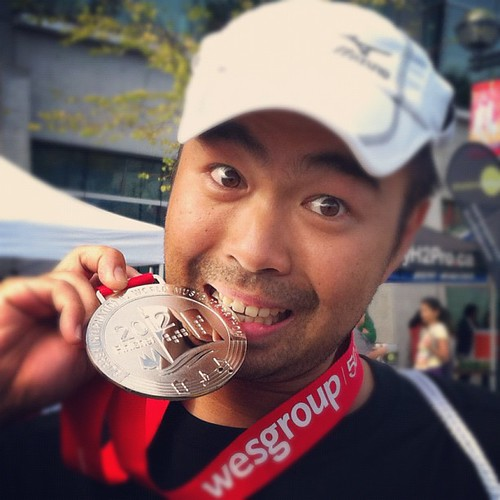 Posing with the finisher's medal for the Surrey Half Marathon