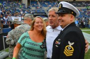 Seahawks head coach Pete Carroll poses for a photo with a Navy Chief