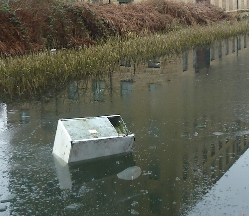 Fridge (whatever) floating in ice-bound canal