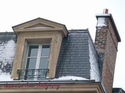 Snowy Paris rooftop