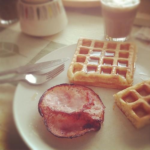 Breakfast: persimmon waffles, fried ham, cappuccino.