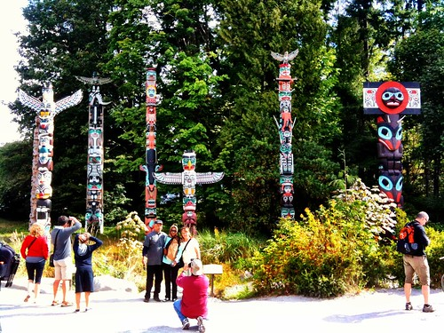 Gathering in front of totem poles