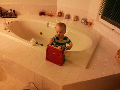 Ong babysits Milo in the bathtub