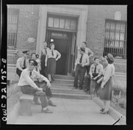 Streetcar operators relaxing on the steps of Capital Transit's Northern Division in June 1943