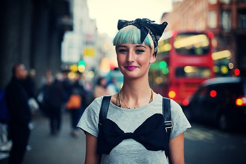 A green haired girl wearing big bow