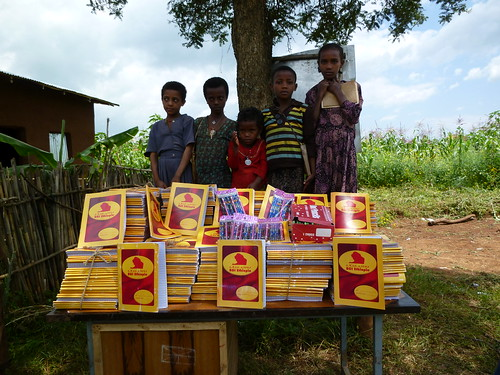 Arbisi students received donation of BGI's 1000 Exercise books and pencils