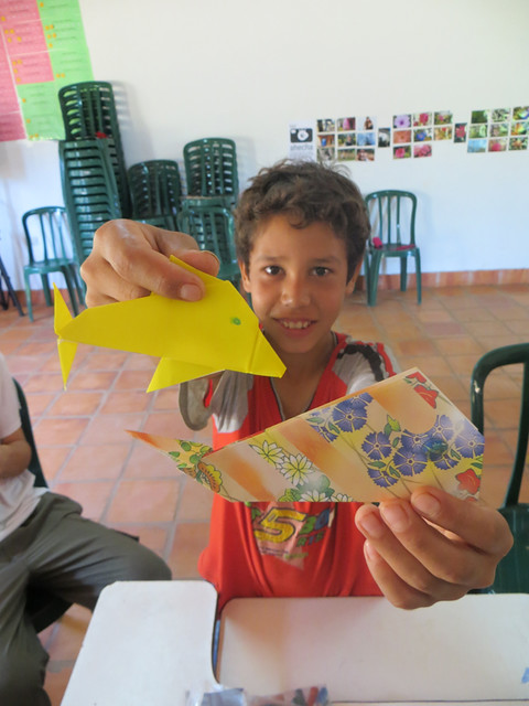 kid with dolphin and whale origami
