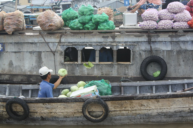 Buying Cabbage at the Floating Markets in the Mekong Delta