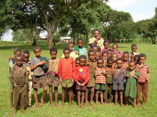 Children in Arbisi spend their days in the field herding cattle