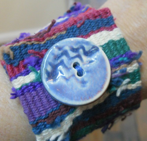 Handwoven cuff, blue button