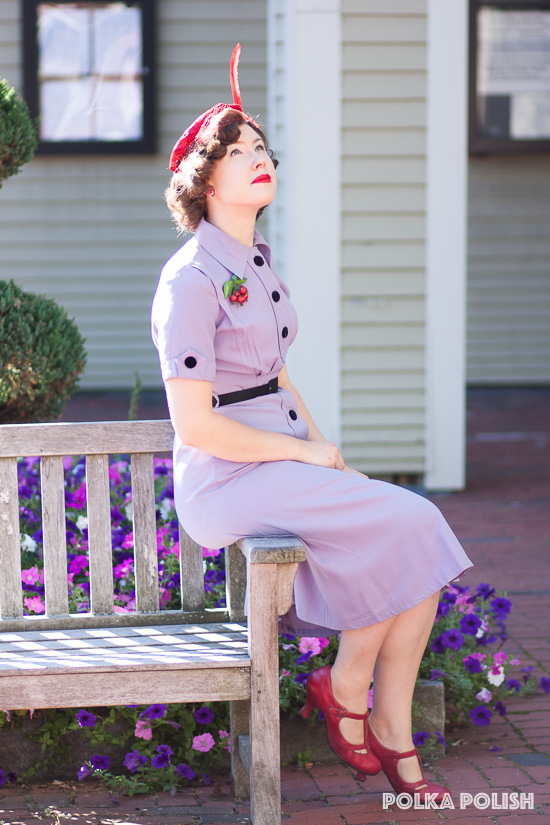 Vintage late 40s or early 50s ensemble featuring a pale purple dress with a red hat and shoes