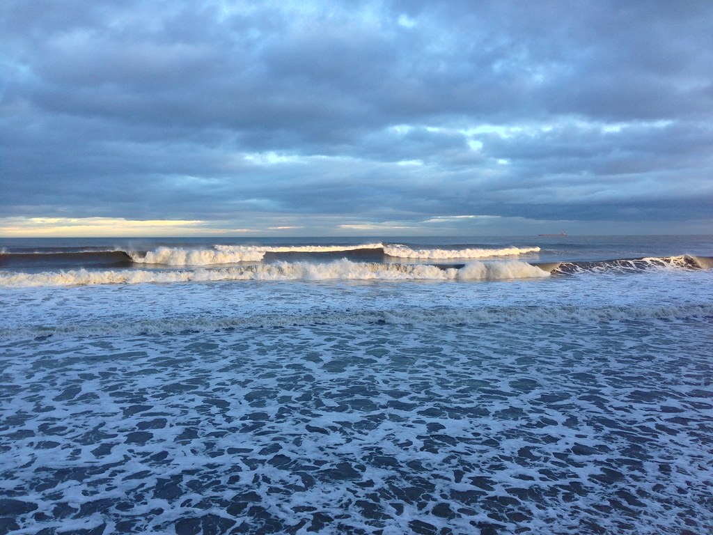Panorama of sea swell in the winter sunlight - Whitley Bay promenade, Tyne and Wear