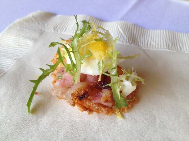 Bacon, egg and frisee on a potato chip