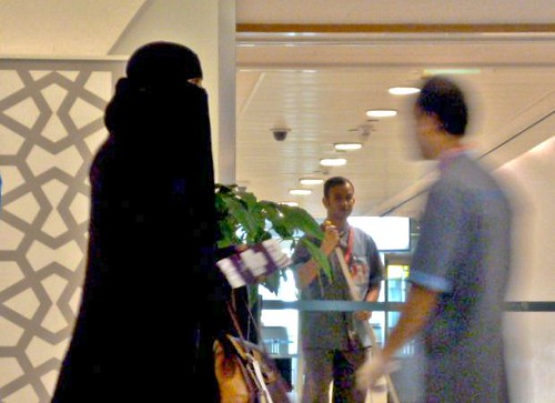 General Views of Abu Dhabi Airport - Lady in Black by Angela Seager