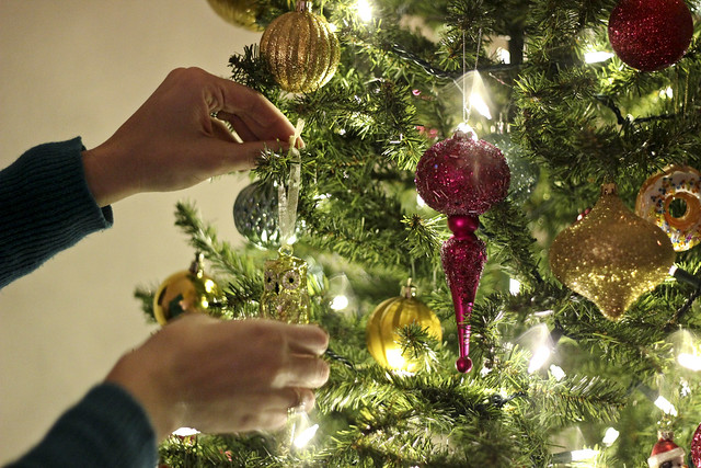 hanging an ornament on the tree