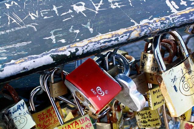 red lovers lock bridge paris