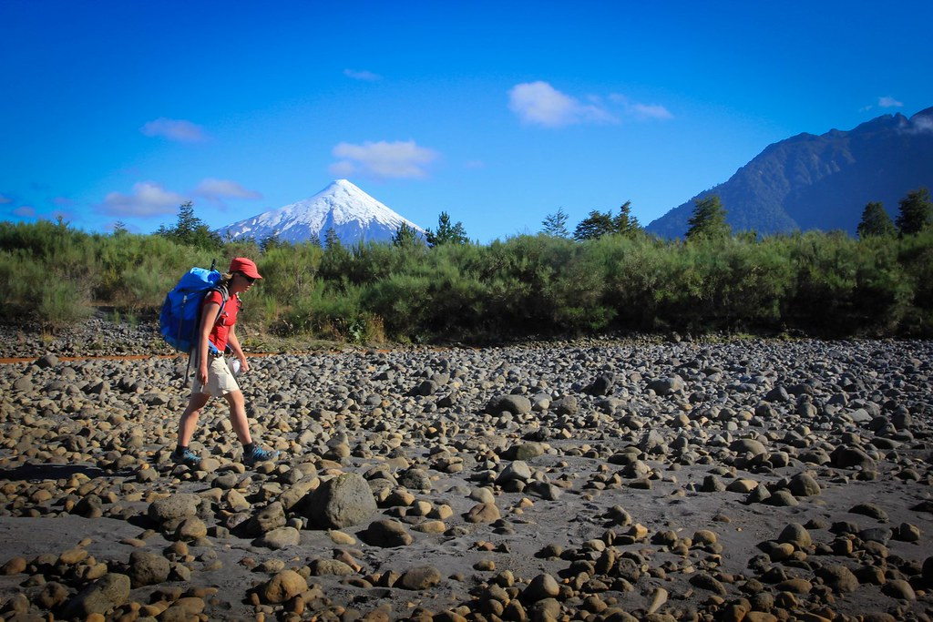Following a creek towards the Rio Petrohue which we were going to float towards the Pacific. Volcan Osorno rising above. Chilean Patagonia.