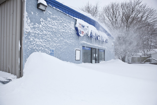 Auto Parts store buried by snow drifts in Holbrook, New York