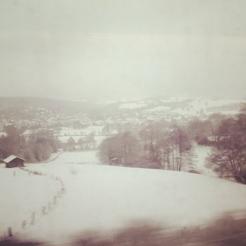 Outside the window on our train to Prague, a world in white gets underway.