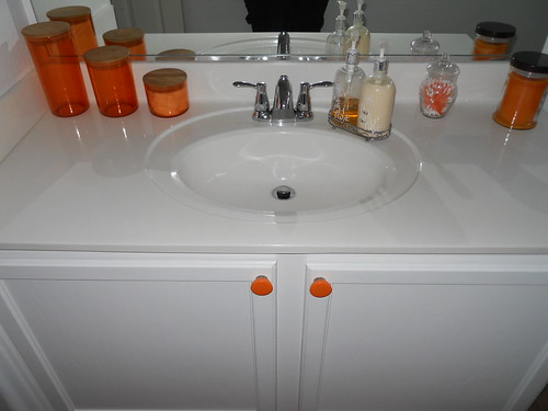 After: White cabinets and orange accouterments