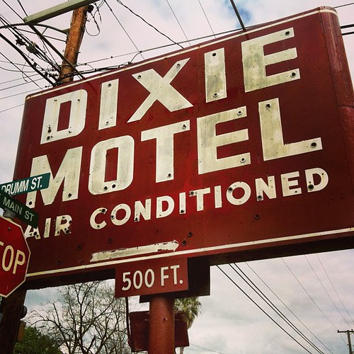 """Air conditioned"" -- a key selling point in Texas! Dixie Motel's vintage neon sign. In Brenham, Texas."