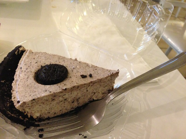 Big slice of cheesecake with a cookie-crumb crust.