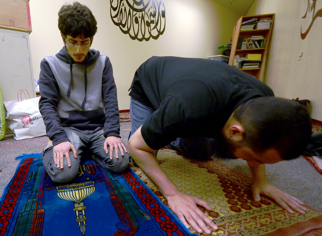 SF State's Muslim Student Association (MSA) members Moaan Ahmed, left, and Ali Al-Arabi, right, pray in room C-139 in the lower level of the Cesar Chavez Student Center on Monday, April 29, 2013. Photo by Frank Leal / Xpress