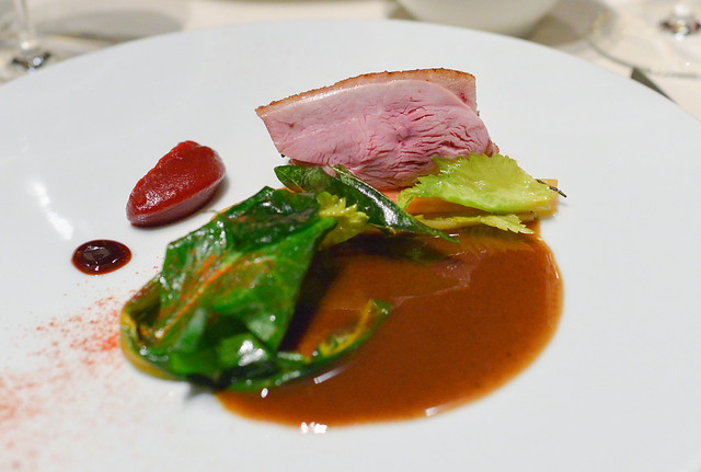 duck with chard, pomegranate, sour cherry