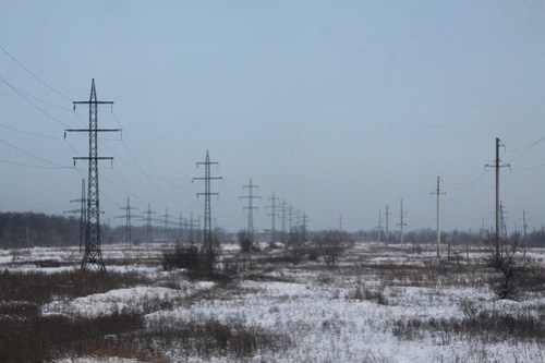 Electrical transmission lines cross the Ukrainian countryside