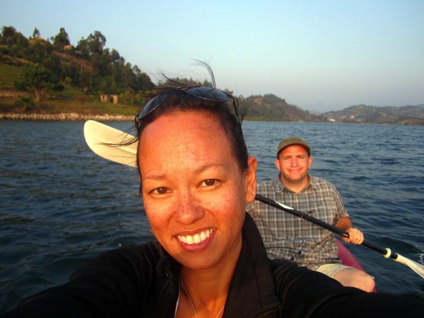 KAYAKING AT LAKE KIVU IN RWANDA.