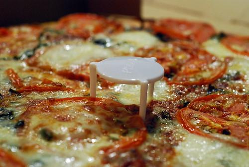 Pizza with plastic tripod