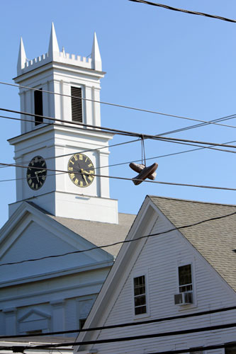 shoes above a street. cape cod, mass.