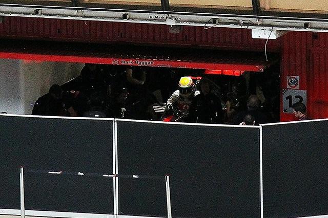 Lewis Hamilton climbs out of his McLaren at Formula One Winter Testing, Circuit de Catalunya, March 2012