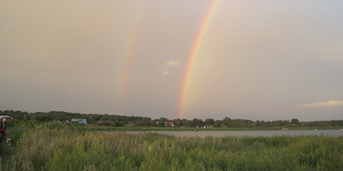 Double rainbows with small dog on the side