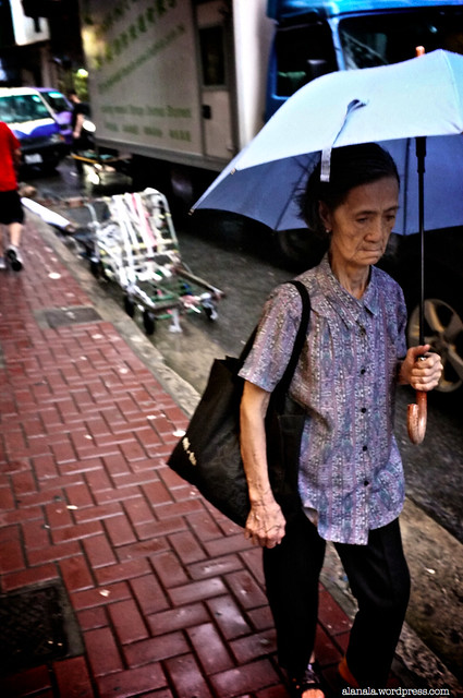 Old lady in the rain