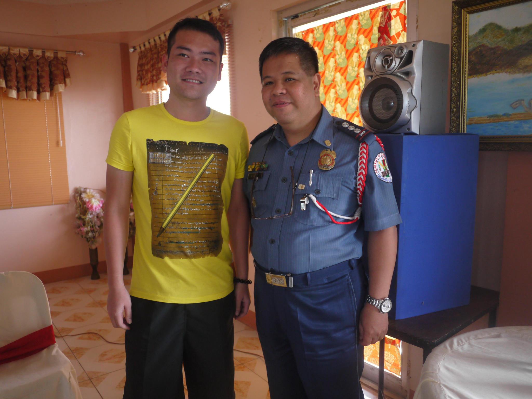 Chinese tourist in a photo op with the Provincial Director, Police Senior Superintendent