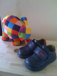 Picture of my daughter's first shoes (bought from Start-Rite's range 'for boys'), sturdy navy-blue shoes with red detail.