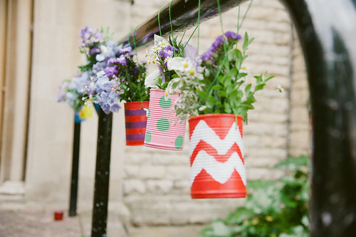 Hanging tin-can flowers