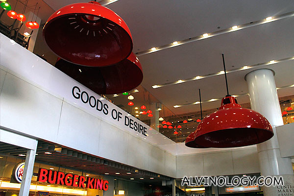 UFO-like red lampshades along the escalator leading up to the store
