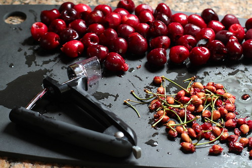 handy cherry pitter, pitted cherries, stems and pits