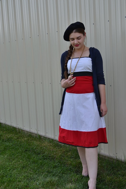 Colorblocked Red-White-Blue Dress with navy cardigan, navy beret, and gold pocketwatch