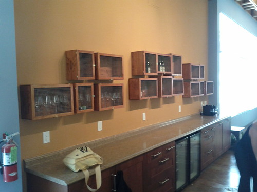 I refinished wine boxes and put doors on them for storage at Cross Campus